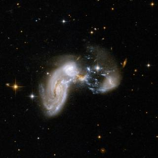 Figure 1: Example of a galaxy merger Credit: NASA, ESA, the Hubble Heritage Team (STScI/AURA)-ESA/Hubble  Collaboration and A. Evans (University of Virginia,  Charlottesville/NRAO/Stony Brook University)
